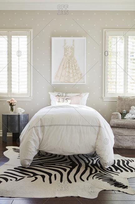 December 9, 2020: Stylish little girl room interior with polka dot walls and zebra rug