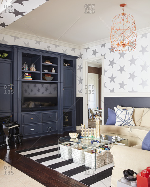 December 9, 2020: Fun family living room with stars on the walls and baskets filled with children's toys