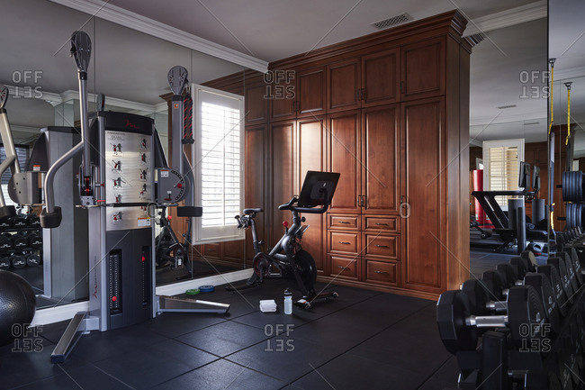 December 9, 2020: Interior of a large home gym filled with modern equipment and weights