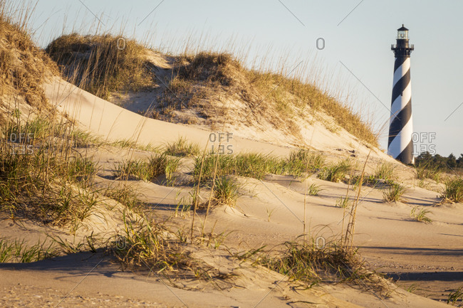 Cape Hatteras Lighthouse set behind sand dunes in the early morning light