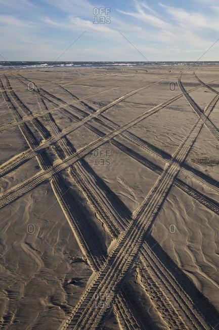 Four wheel drive tire tracks criss cross in the sand on Ocracoke Island, North Carolina