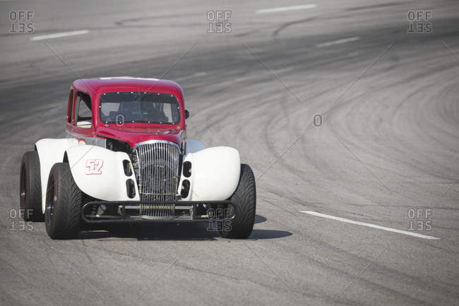 Cape Carteret, North Carolina - June 10, 2017: A red and white Legends race car at a local paved quarter mile track