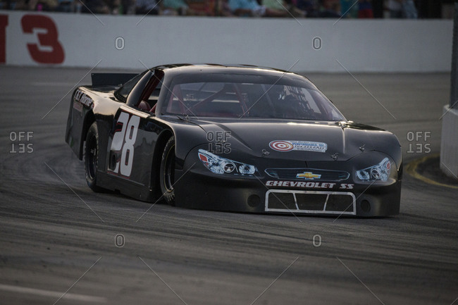 Cape Carteret, North Carolina - June 10, 2017: A Late Model race car rounding Turn 3 of a local paved quarter mile track