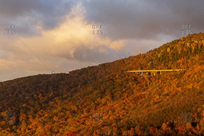 Sunrise casting golden light onto the Linn Cove Viaduct along the Blue Ridge Parkway in Western, North Carolina