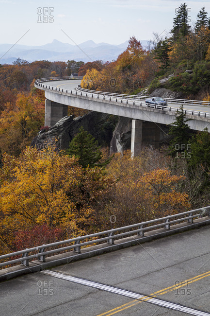 A truck driving on the Linn Cove Viaduct along the Blue Ridge Parkway in Autumn