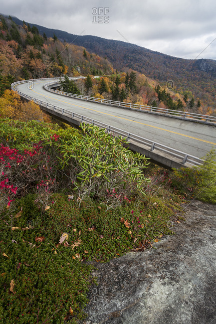 Linn Cove Viaduct surrounded by peak fall color along the Blue Ridge Parkway in Western, North Carolina