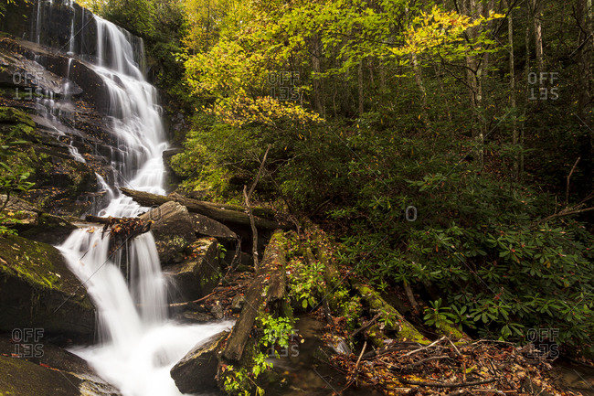 Peak fall colors surround Eastatoe Falls outside of Rosman, North Carolina