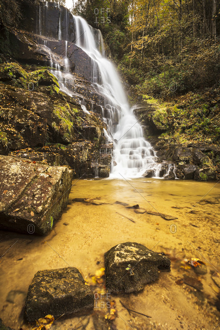 Eastatoe Falls outside of Rosman, North Carolina with soft light and peak fall color which add to the beauty of the scenic landscape