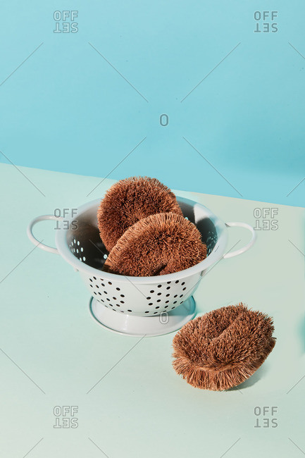 High angle of assorted eco friendly hygienic supplies for skin treatment in shower placed on blue background in studio