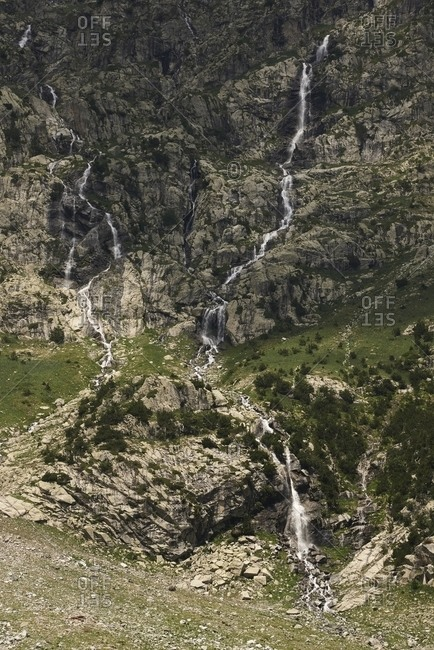 Amazing landscape of powerful waterfall in rocky highland area on overcast day in Barrosa cirque