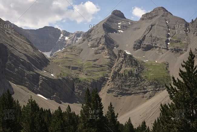 Scenic view of rocky peaks of mountain ridge on sunny day in summer