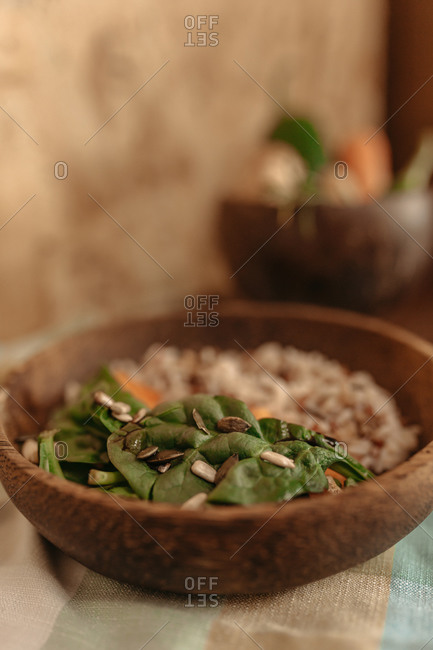 Appetizing rice with various chopped fresh vegetables served on table for vegetarian lunch