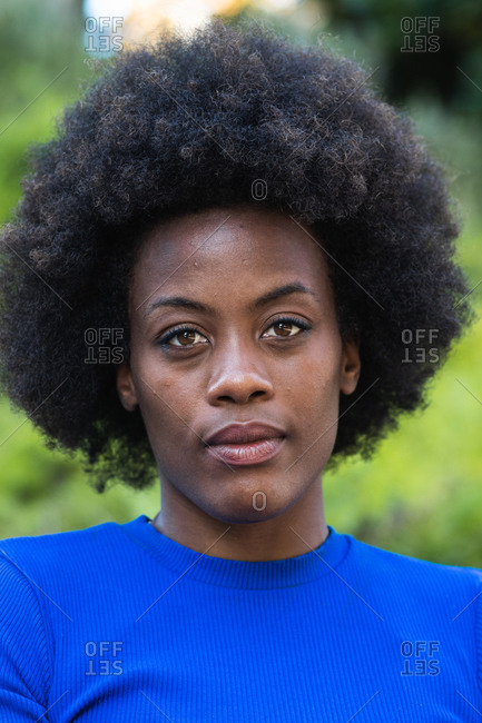 Black female with Afro hairstyle looking at camera