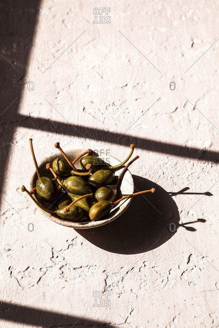 Capers in a bowl in the sun