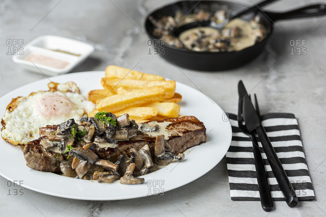 Steak and Mushroom Meal With Fries