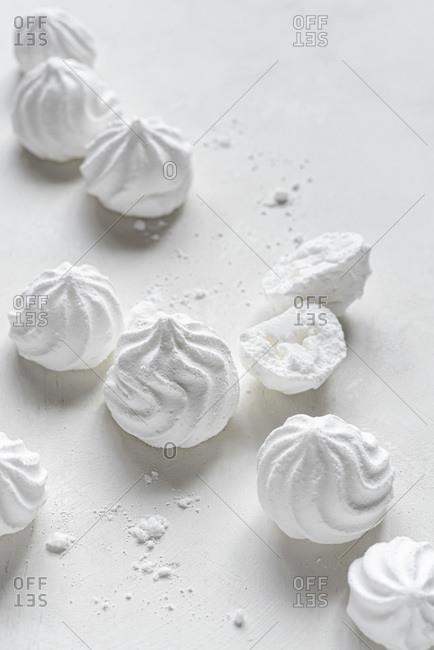 White meringues on white background