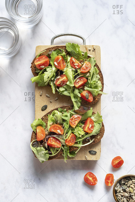Bruschetta with salad and tomatoes