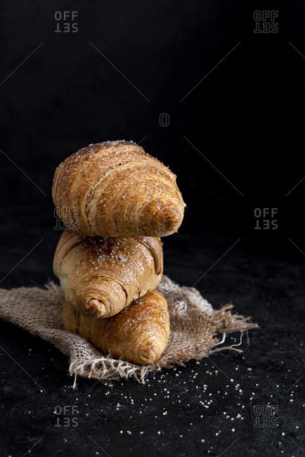 Three Brioche Croissants over Dark Background