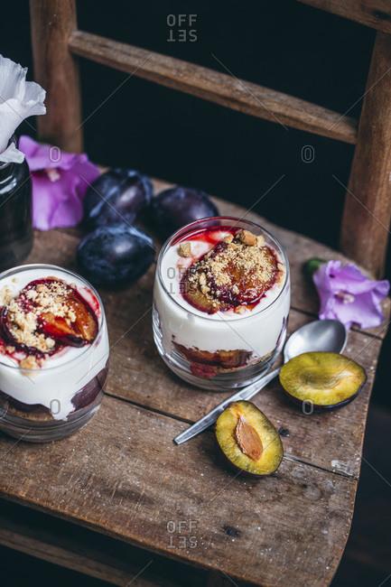 Roasted plums and yogurt parfait dessert