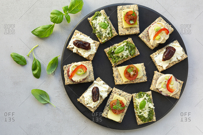 Gluten Free Crackers with various toppings.