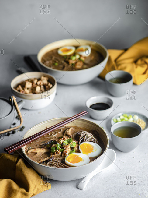 Hot soba noodles with chopsticks on a table