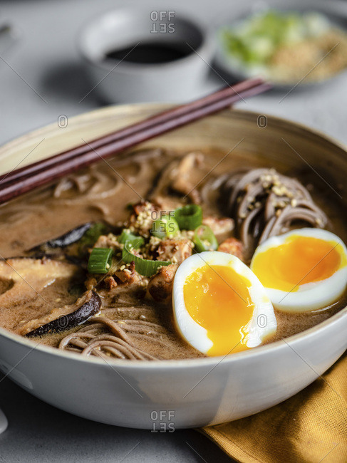 Hot soba noodles with chopsticks on a table, close up