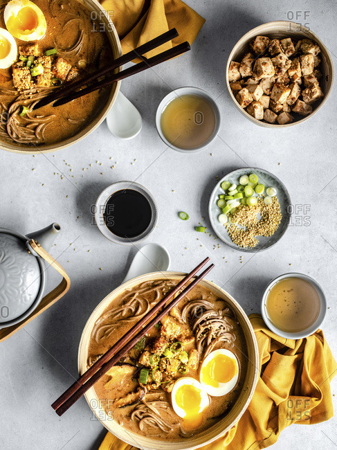 Hot soba noodles with chopsticks on a table, top view