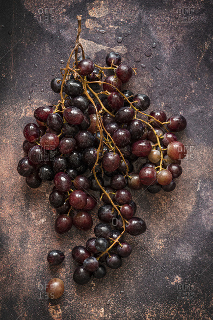 Bunch of fresh grapes over dark background