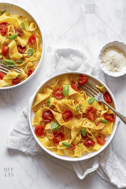 Tagliatelle served with Cherry Tomatoes Basil Parmesan