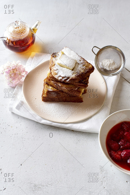 French toasts for breakfast with butter and powdered sugar
