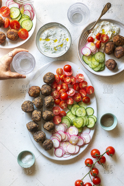 Vegetarian meatballs with tzatziki sauce and vegetables on the plate