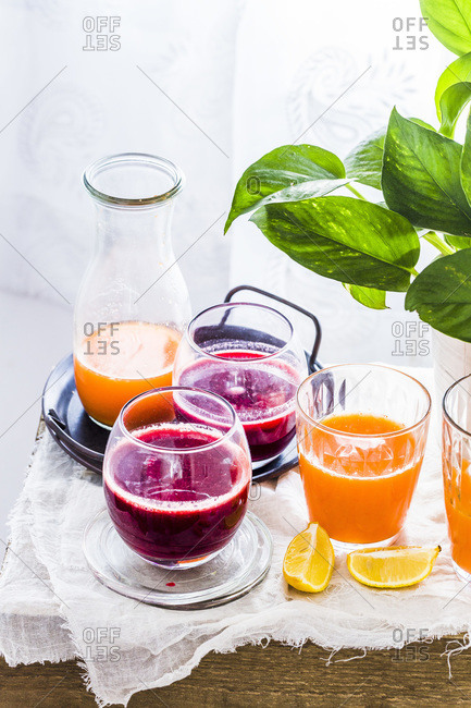 Beet Carrot Apple Juice, Orange Carrot Ginger Juice served in glasses