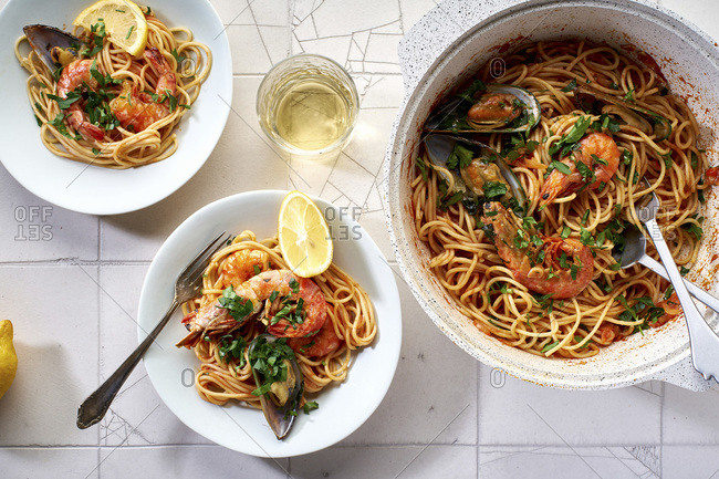 Top view of seafood pasta with shrimps, mussels and tomato sauce