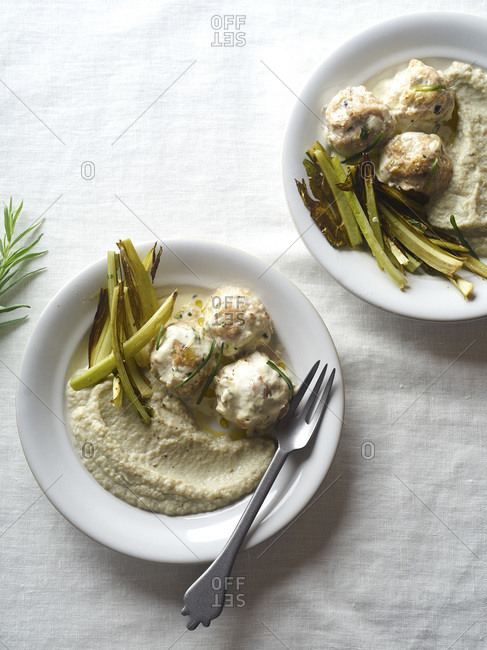 Meatballs with pork and apples served with cauliflower puree and roasted greens