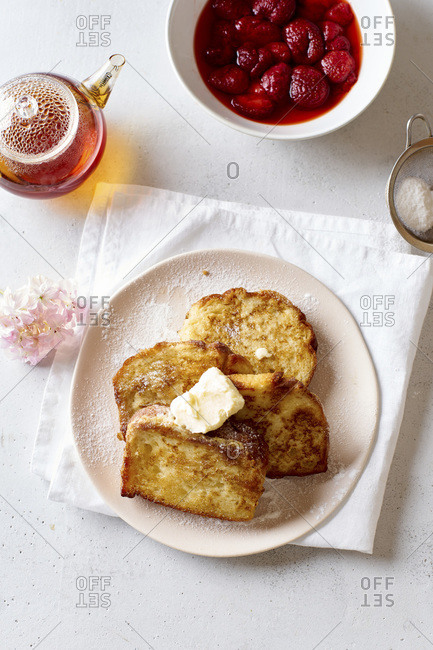 French toasts for breakfast with butter and powdered sugar view from above