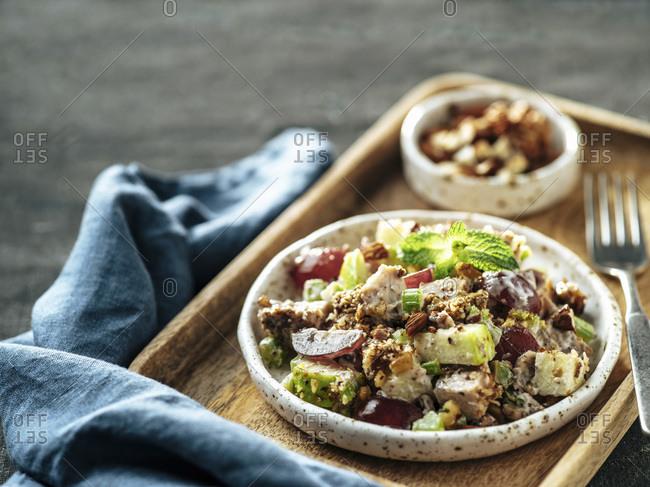 Waldorf salad on wooden tray.