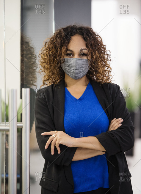 Portrait of businesswoman wearing face mask in office