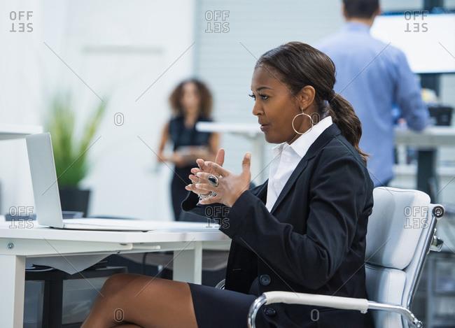 Businesswoman having video call via laptop in office