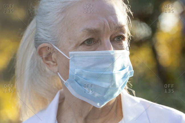 Portrait of senior female medical staff in covid protective mask