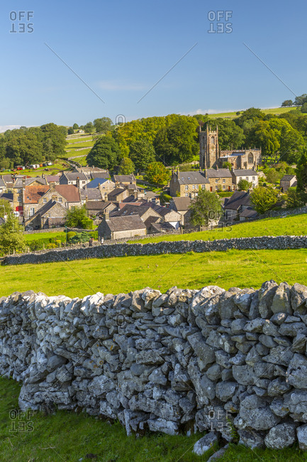 View of village church, cottages and dry stone walls, Hartington, Peak District National Park, Derbyshire, England, United Kingdom, Europe