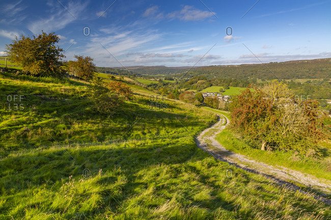 View of track leading to Calver Village overlooked by Curbar Edge, Calver, Derbyshire Peak District, Derbyshire, England, United Kingdom, Europe