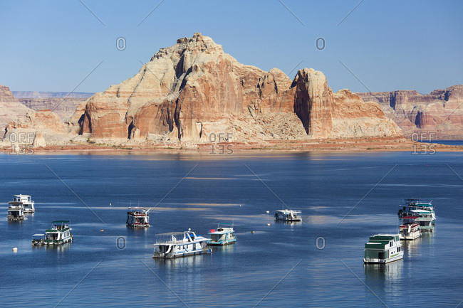 October 26, 2017: Houseboats moored in Wahweap Bay, Castle Rock beyond, Lake Powell, Glen Canyon National Recreation Area, Page, Arizona, United States of America, North America