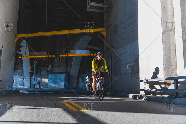 Cyclist emerging from tunnel, Ontario, Canada