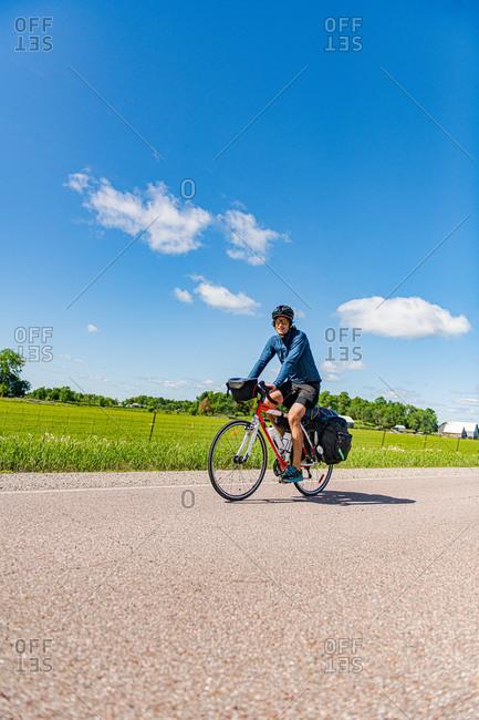 Cyclist on road, Ontario, Canada