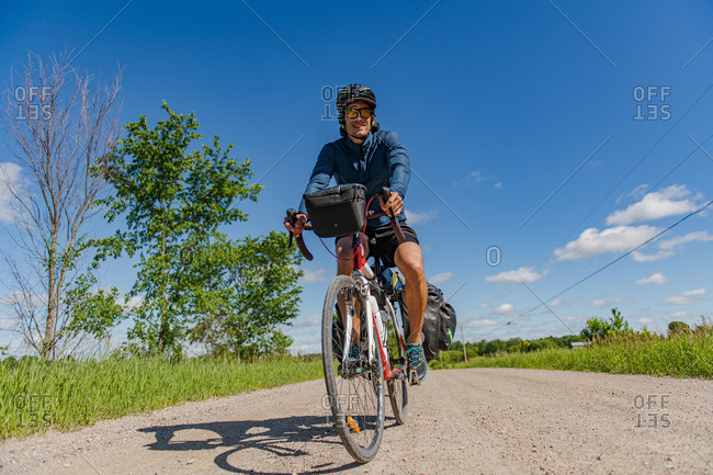 Cyclist on bicycle, Ontario, Canada
