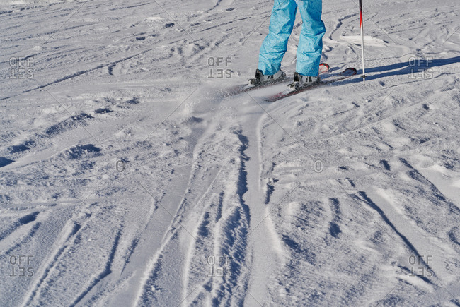 Cropped view, people skiing at Formigal, Spain