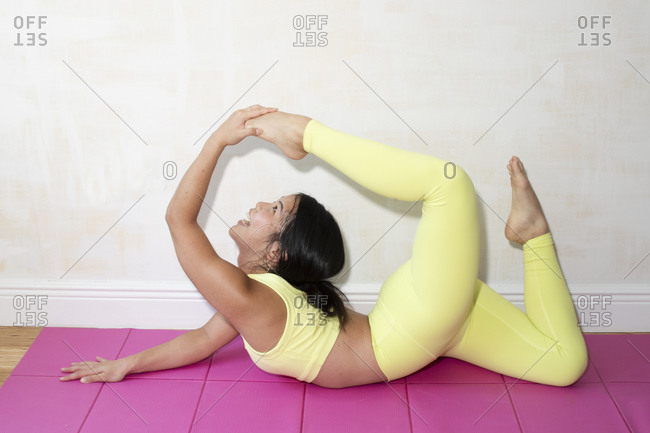 Contortionist working on a mat