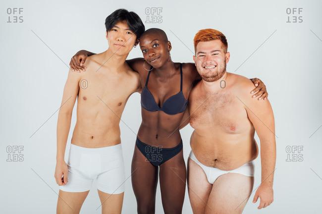 Female and male friends wearing underwear