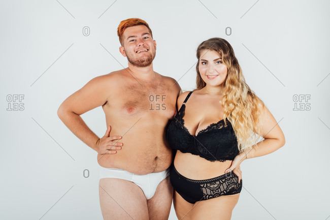 Confident young couple wearing underwear