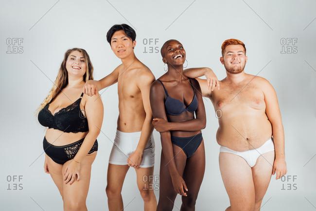 Confident friends together, wearing underwear